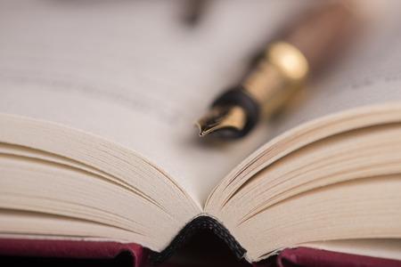 Open book and fountain pen photo
