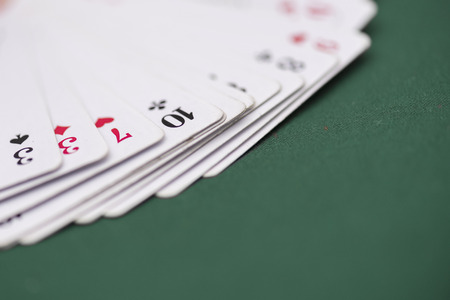 queen of clubs: Playing cards over green matte
