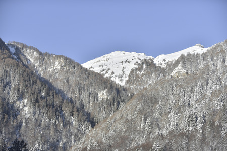 mountainscape: Winter mountainscape and blue sky Stock Photo