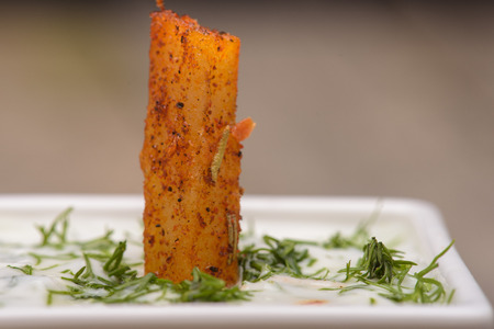 french fries plate: French fries spiced presented on a white plate  with rosemary Stock Photo