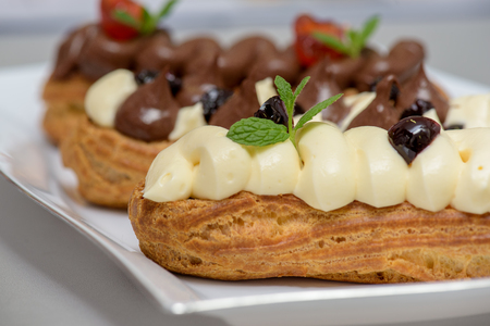 profiterole: Eclairs with chocolate custard and whipped cream