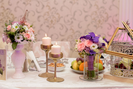 Arrangement for table with fruits, flowers and candles for christening party