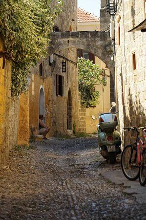 Curling street of ancient Rhodes city Stok Fotoğraf