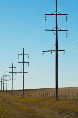 Sunlight reflecting on electrical power lines Stock Photo