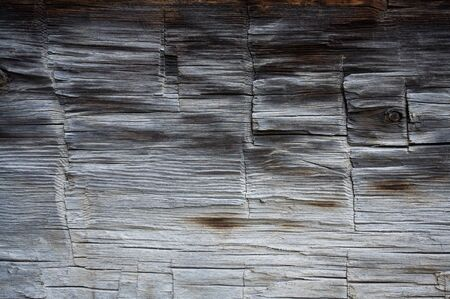 dovetail: Weatherd wood on side of old log cabin Stock Photo