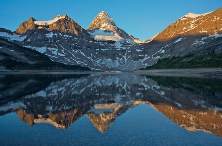assiniboine: Mount Assinboine reflected in Lake Magog Stock Photo