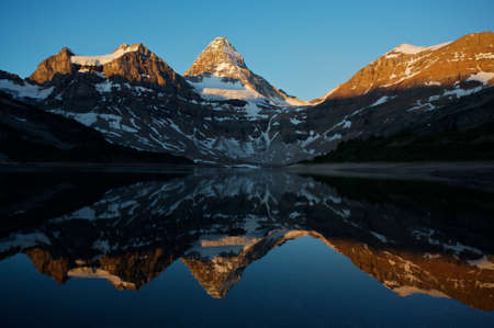Mount Assiniboine in the Canadian Rockies with early morning light Stock Photo