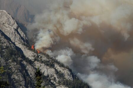 Huge flames burning on a ridge in the Rocky Mountains