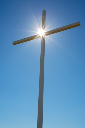 Cross with the sun behind it Stock Photo