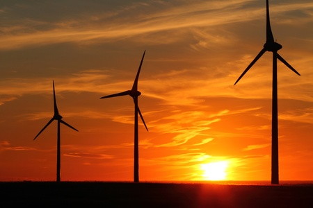 Wind turbines with dramatic sunset clouds