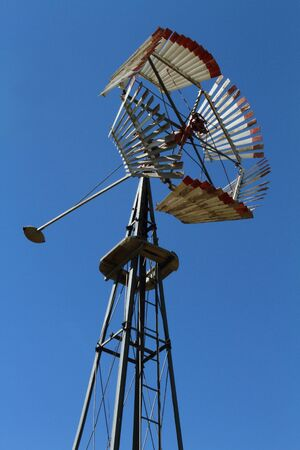 Old fashioned windmill on blue sky