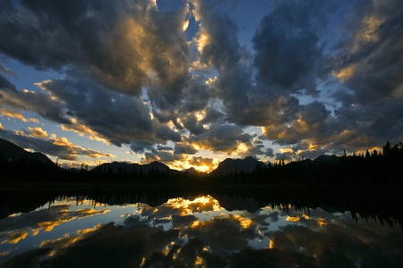 canadian rockies: Sunset with dramatic clouds over Buller Lake in the Rocky Mountains of Canada