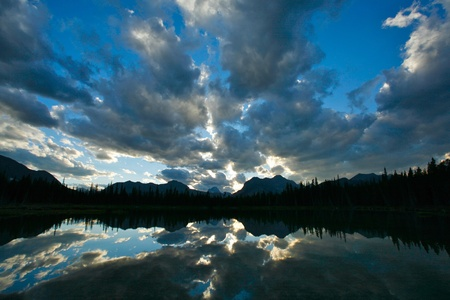 Sunset with dramatic clouds over Buller Lake in the Rocky Mountains of Canada