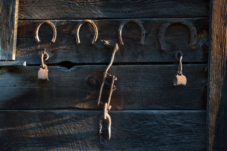 Antique horse shoes hanging on the side of old barn