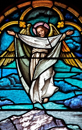 stained glass window: Stained glass church window depicting an angel Editorial