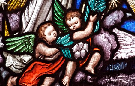 Stained glass church window depicting cherubic angels