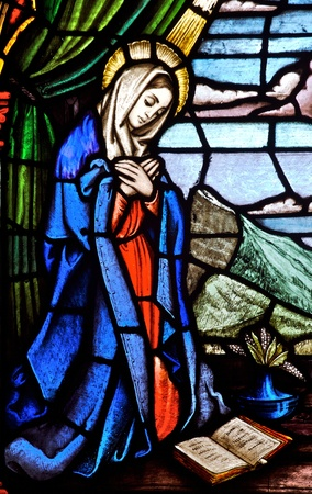 Stained glass church window depicting the Virgin Mary