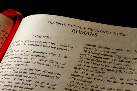 Chapter 1 of Epistle to the Romans in the New Testament of the Holy Bible Stock Photo - 12598005