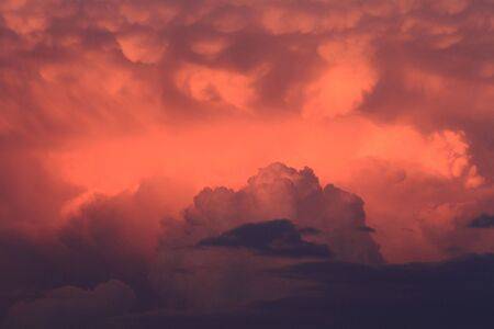 deeply: Deeply colored storm clouds in the evening sky