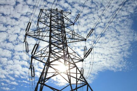 electric grid: Electrical power pylon with dramatic background clouds Stock Photo