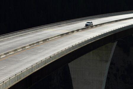 guard rail: Single car crossing a high level bridge in British Columbia Stock Photo