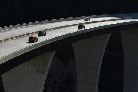 guard rail: Cars crossing a high level bridge in British Columbia