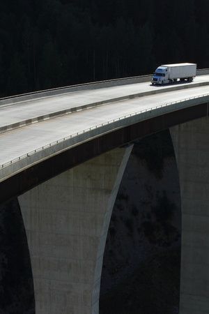Semi-trailer truck crossing a high level bridge in British Columbia