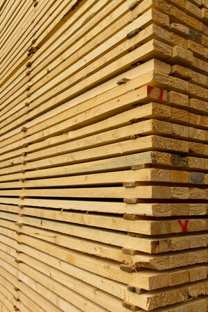 Pile of stacked rough cut lumber at a sawmill