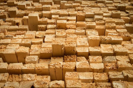 2x4 wood: Pile of stacked rough cut lumber at a sawmill