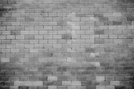 白と黒の大型コンクリート ブロック壁のテクスチャ