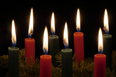 boughs: Red and green Christmas Candles and spruce tree boughs
