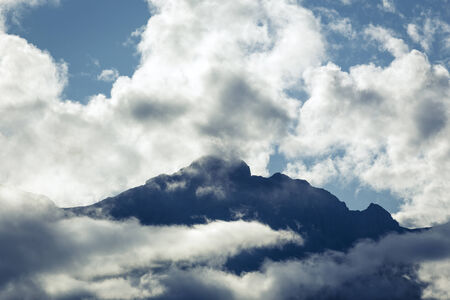 Clouds lift up from a mountain ridge after a summer rain shower in the Canadian Rockies