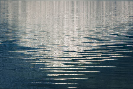 canadian rockies: Gentle waves with reflections on an alpine lake in the Canadian Rockies