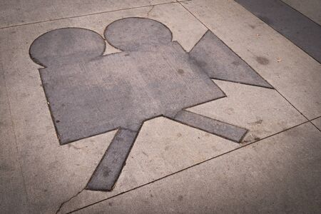 grungy: Grungy camera shape in a concrete sidewalk