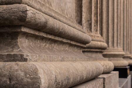 Close up architectural details of the base of  Corinthian style stone pillars. Foto de archivo