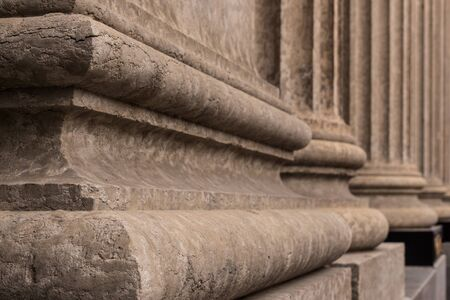 Close up architectural details of the base of  Corinthian style stone pillars. Stock Photo
