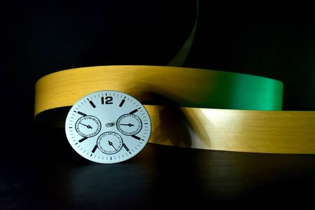 A white watch with ribbon objects stock photograph