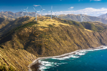 landscape with hills, ocean and wind turbines, location - Wellington, North Island, New Zealand