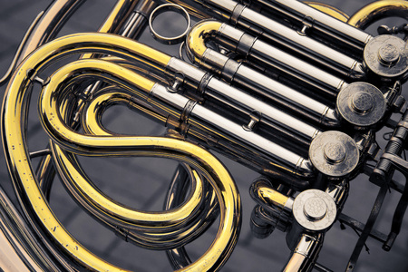 part of the golden and silver metal retro-styled trumpet