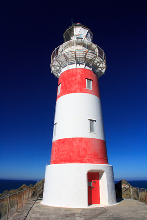 navigational light: White and red striped lighthouse, location - Cape Palliser bay lighthouse, Wairarapa, North Island, New Zealand