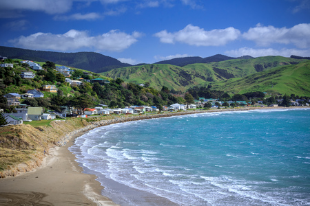 sea and green hills landscape, location - Castlepoint, North Island, New Zealand Stock Photo