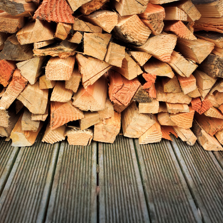 chopped firewood stack at the wooden floor Stock Photo