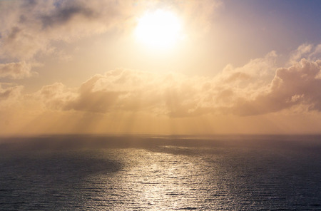 sea landscape with sun rays, location - Wellington, North Island, New Zealand