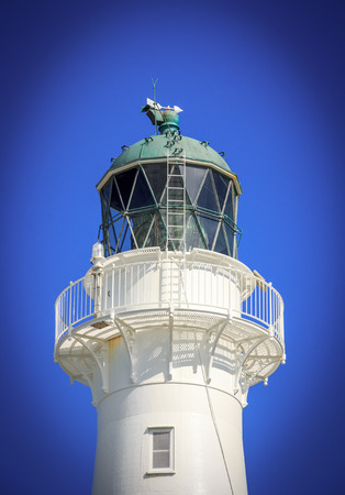 White lighthouse, location - Castlepoint, North Island, New Zealand Stock Photo