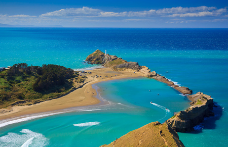 White lighthouse, location - Castlepoint, North Island, New Zealand Stock Photo