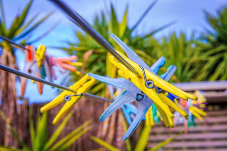 clothespegs: colored clothespins outdoor. Soft selective focus and shallow depth of field