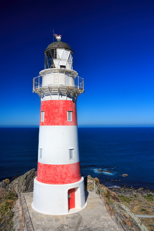 White and red striped lighthouse, location - Cape Palliser bay lighthouse, Wairarapa, North Island, New Zealand