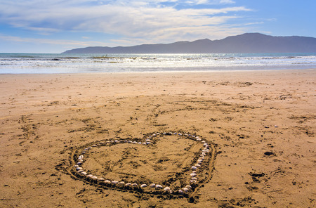 Heart made from seashels at the beach, location - Wellington, Kapiti Island, North Island, New Zealand