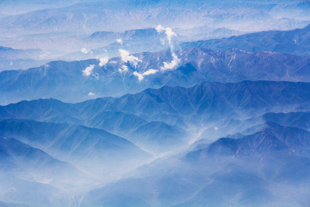 Beautiful mountains and clouds landscape - aerial view Stock Photo