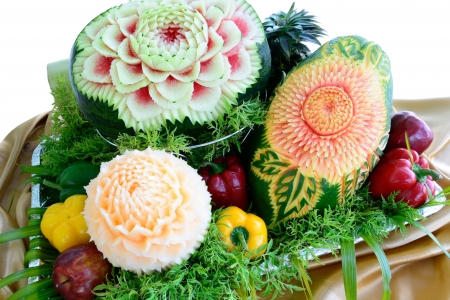 Fruit carvings on the buffet table,isolated on white Standard-Bild
